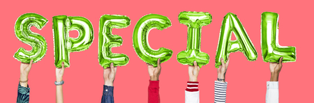 Green alphabet balloons forming the word special