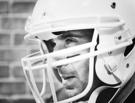 Man wearing Amerian football helmet Stock Photo