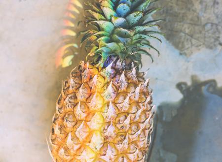 Closeup of fresh pineapple with rainbow prism light