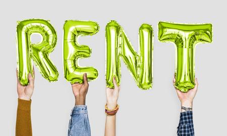 Green alphabet balloons forming the word rent Standard-Bild - 106476249