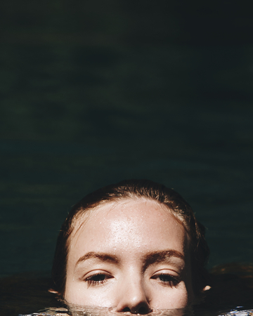 Portrait of a beautiful woman under water