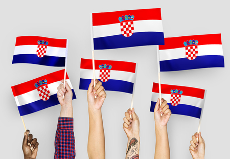Hands waving the flags of Croatia