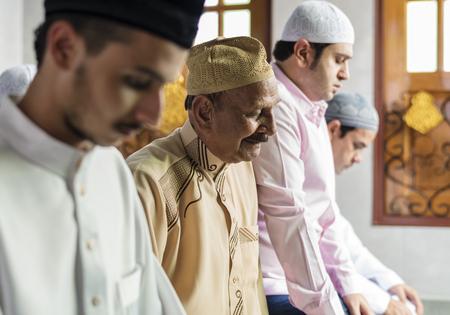 Muslim prayers in Tashahhud posture Stock Photo - 106476403