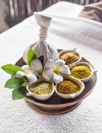 Herbal ball hot compress massage Stock Photo