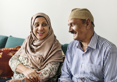 Happy Middle Eastern mature couple at home Stock Photo - 106476502