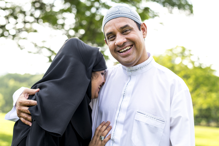 Muslim married couple in the park