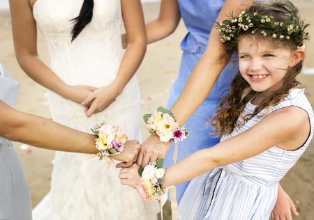Little bridesmaid at a beach wedding Standard-Bild - 106476563