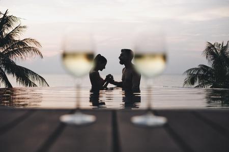Couple enjoying a romantic sunset Stock Photo - 106476577