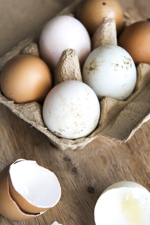 Eggs on wooden background 스톡 콘텐츠 - 116130347