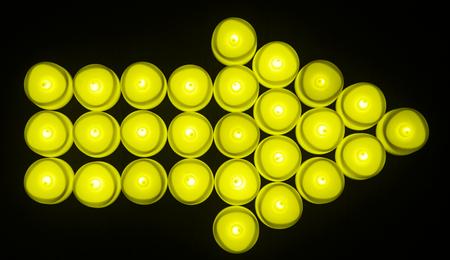Yellow light bulbs arrow shape
