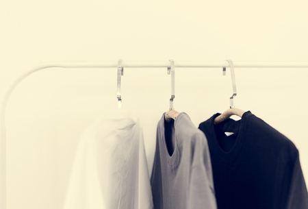 Basic Color Clothes Hanging on a Rack