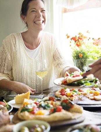 Woman enjoying a pizza dinner Stock Photo