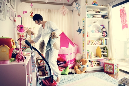Mother cleaning daughters room