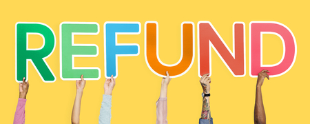 Hands holding up colorful letters forming the word refund