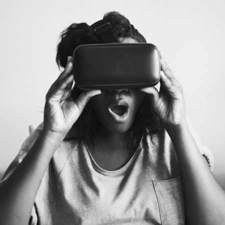 Woman experiencing virtual reality with a VR headset Stock Photo