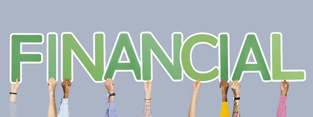 Hands holding up green letters forming the word financial