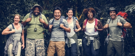 Group of happy diverse campers