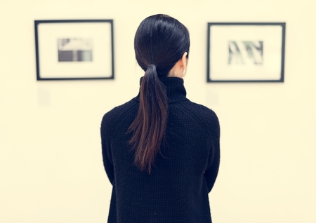 Woman looking at the art exhibition