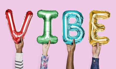 Colorful alphabet balloons forming the word vibe 版權商用圖片