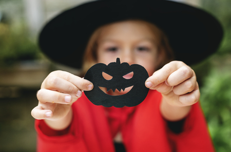 Young playful girl enjoying the Halloween festival Stockfoto