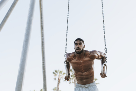 Fit man working out at the beach