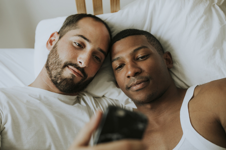 Couple taking a selfie in bed Stock Photo
