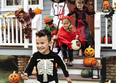 Young kids trick or treating during Halloween Stok Fotoğraf