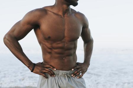 Fit man posing at the beach