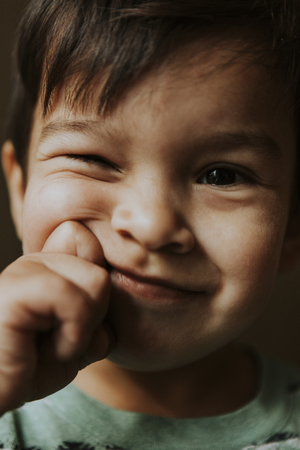 Playful boy making playful faces