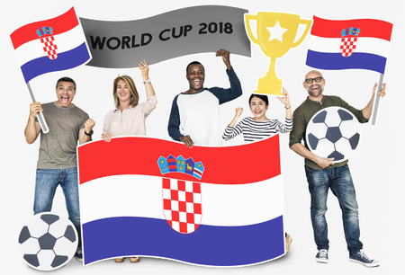 Diverse football fans holding the flag of Croatia