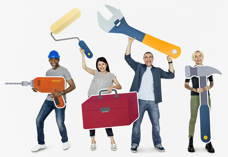 Cheerful diverse people holding tools Banco de Imagens