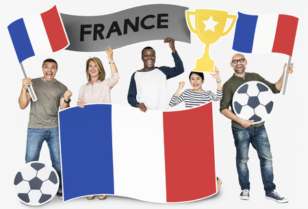 Diverse football fans holding the flag of France