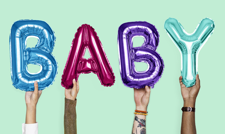 Hands showing baby balloons word Stock Photo