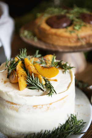 Buttercream cake with apricot and rosemary Reklamní fotografie