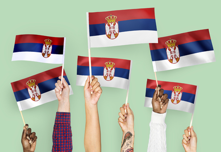 Hands waving the flags of Serbia 版權商用圖片 - 108321231