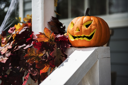 Halloween pumpkins and decorations outside a house Stock Photo