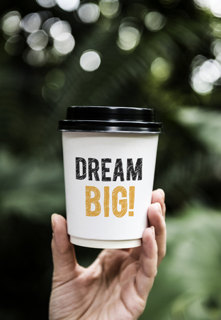 Wording Dream big on a paper coffee cup