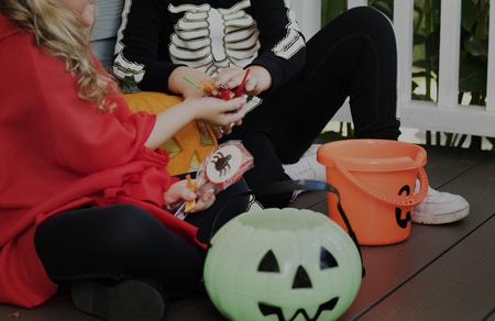 Little children trick or treating on Halloween Stock Photo