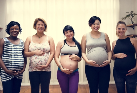 Pregnant women in a class Stock Photo