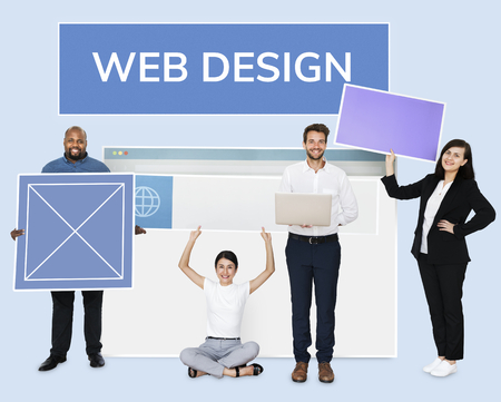 Happy diverse people holding a wed design board