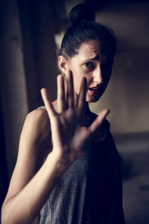 Woman gesturing with panic face