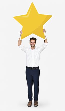Businessman showing golden star rating symbol