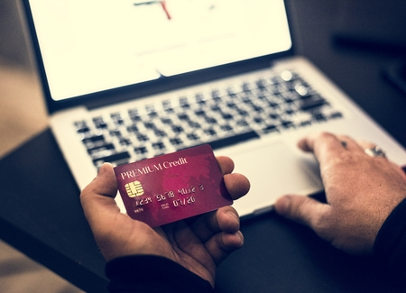 Man holding a credit card with online transaction concept Stockfoto