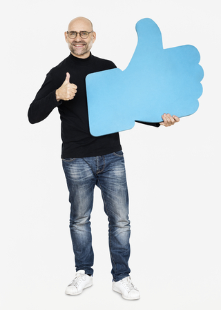 A man holding a thumbs up icon