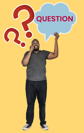 Confused man with a question Stock Photo