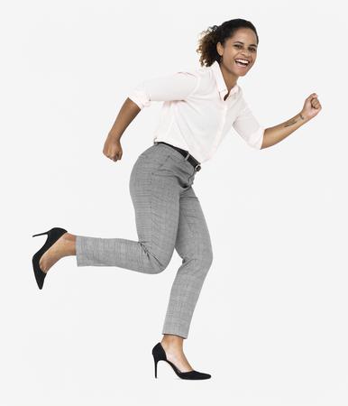 Cheerful businesswoman running towards success