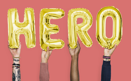 Hands showing hero balloons word Stockfoto - 109220613