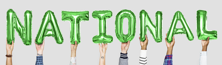 Green alphabet balloons forming the word national Stock fotó