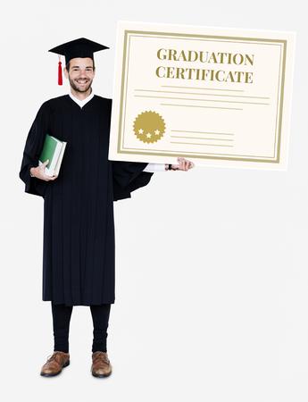 Male grad holding a graduation certificate Stock Photo
