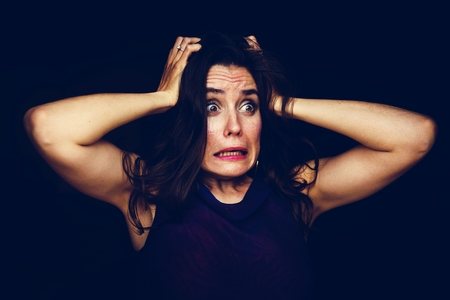 Woman gesturing panic face expression Stockfoto - 109365215